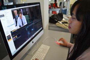 Arieshadela Irwantini editing a video using Adobe Premier Pro. Photo Courtesy of Anika Durisova