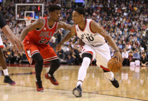 Mar 14, 2016; Toronto, Ontario, CAN; Chicago Bulls forward Jimmy Butler (21) defends against Toronto Raptors guard DeMar DeRozan (10) at Air Canada Centre. The Bulls beat the Raptors 109-107. Mandatory Credit: Tom Szczerbowski-USA TODAY Sports