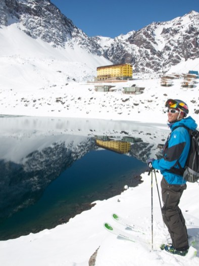 Professional skier Chris Davenport stands on the shores of the Lake of the Inca | photo: Adam Clark, Portillo