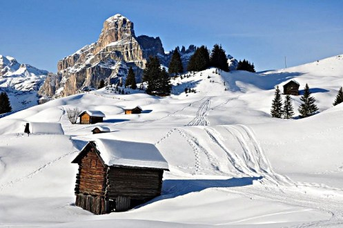 Italy's Alta Badia is one of the 11 ski resorts accessed by the Dolomiti Superski Pass, a popular pass option for vacationers staying in the classic Alpine village of Cortina. | Photo: Dolomiti Superski Pass