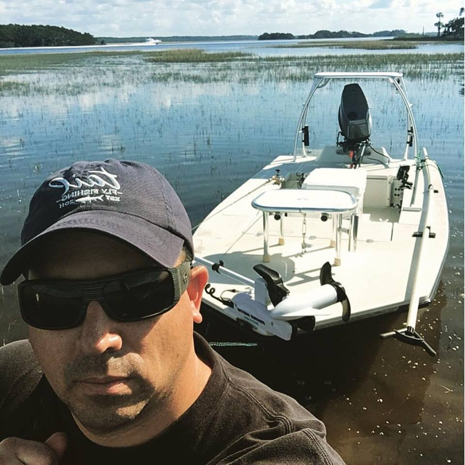 chris white angler art and skiff fisherman