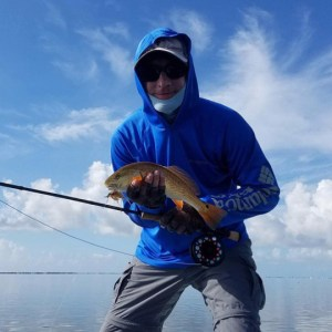 Texas Coast Redfish fun on a skiff. Huge storm blew in but made it back safe. Sc…