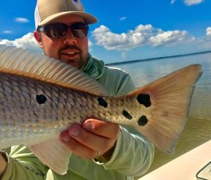 with a  first Redfish!             …