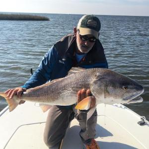 Mike with his biggest redfish on fly to date.                           …