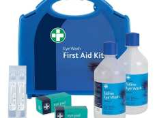 A blue eye wash first aid kit with the contents displayed.