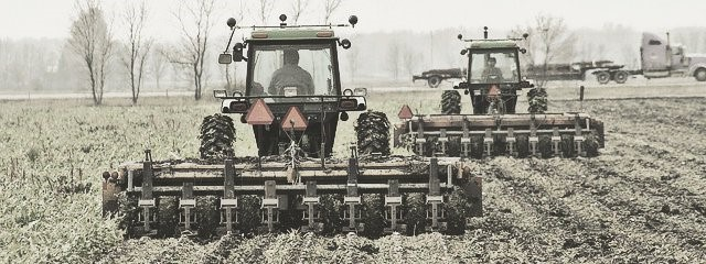 2 Tractors Plowing Farm Land