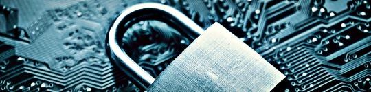 metal padlock laying on a circuit board