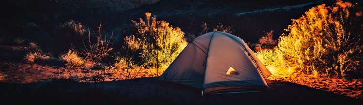Camping Tent At Night In Mountains