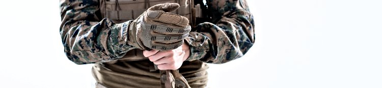 Solider Putting Tactical Gloves On