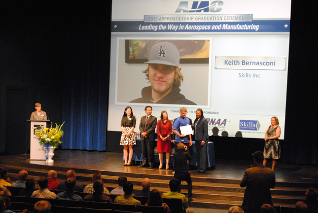 Keith Bernasconi accepts his AJAC certificate one stage at graduation