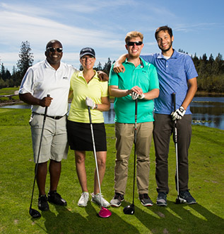 four golfers pose for picture