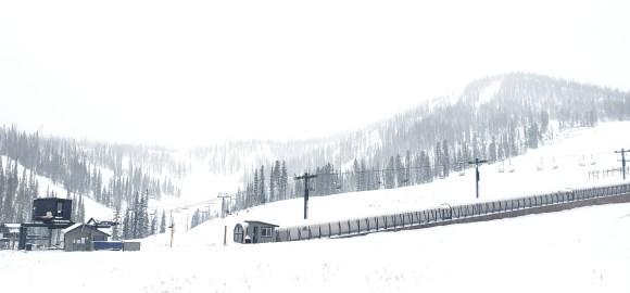 Snowy base area and mountain scene