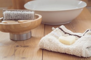 Clean washcloth and warm water - perfect remedy for acne scabs.