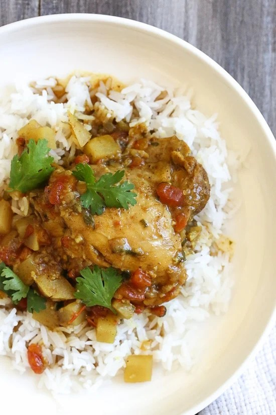 Chicken, garam masala, cumin and curry spices are simmered with potatoes and coconut milk to give this dish an aromatic flavor you'll really enjoy. Serve this over basmati rice for a complete meal (also great with naan or cauliflower rice to keep the carbs low).