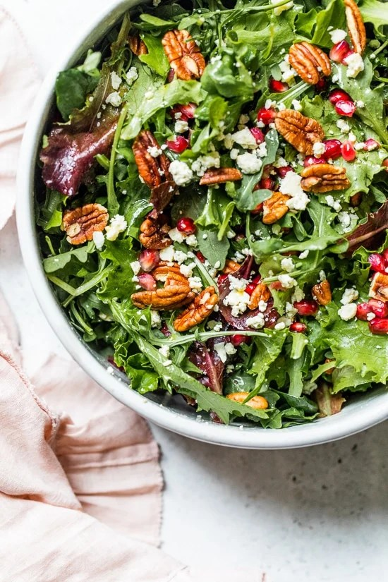 This beautiful, delicious fall or winter salad is made with mixed baby greens, pomegranate, gorgonzola and pecans with a pomegranate vinaigrette.