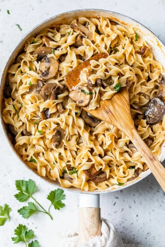 This healthy stroganoff with shiitake, baby portabella, and cremini mushrooms with noodles in a light creamy sauce is a quick and easy meal, perfect for Meatless Mondays!
