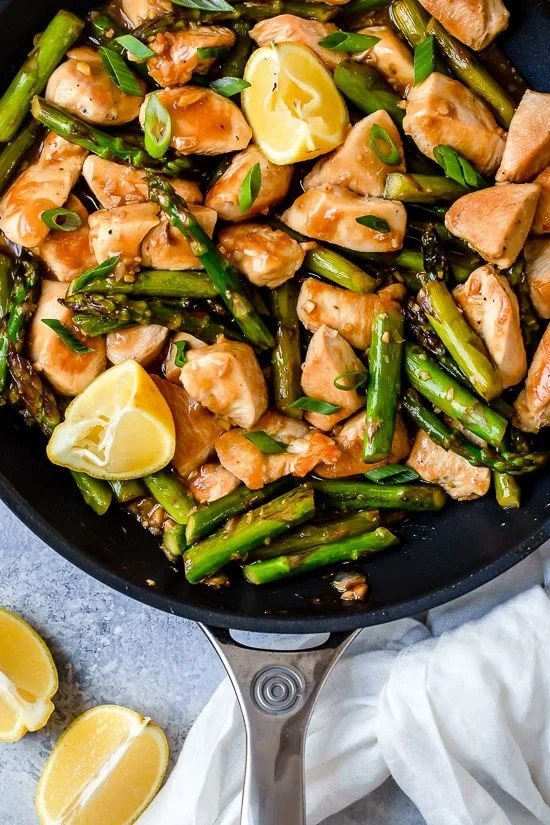 This quick weeknight Chicken and Asparagus Lemon Stir Fry is perfect for spring, made with lean chicken breast, asparagus, fresh lemon, garlic and ginger.