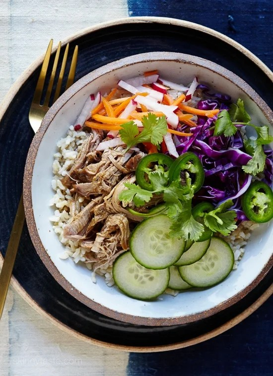 If you've ever had the classic Vietnamese Banh Mi sandwich, you probably know the bread can easily overpower the pork, pickled carrots and all the wonderful flavors, so I scrapped the bread and put all the goodies in a bowl over brown rice (it's great over any grain) in my slim remake which is easy to make any night of the week!