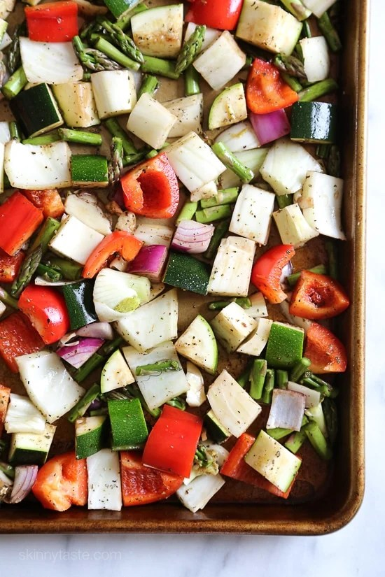 Penne baked with cheese, sauce and loaded with healthy vegetables in every bite. Roasted zucchini, red bell peppers, asparagus, red onion and fennel are tossed with balsamic and herbs then roasted for the best tasting meatless baked pasta dish EVER!