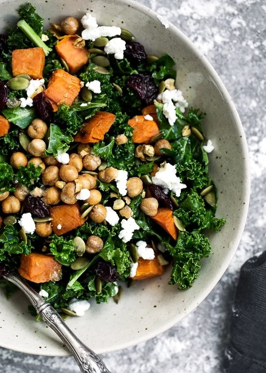 Kale Salad with Roasted Sweet Potato, Dried Cherries, Feta & Pepitas