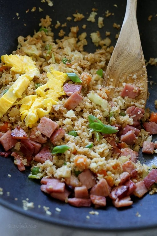 "Cauliflower Fried ""Rice"" with Leftover Ham is a great way to use up that leftover Ham from the Holidays, which uses riced cauliflower in place of rice to make it low-carb and it's delicious!"