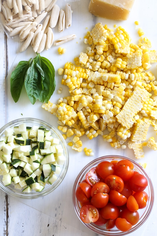 I love this quick, summer pasta dish made with homemade Cavatelli pasta, (can be purchased fresh or frozen in any Italian specialty store) cherry tomatoes, zucchini, corn and marinara. Perfect to whip up on busy weeknights as this dish comes together in less than 20 minutes.