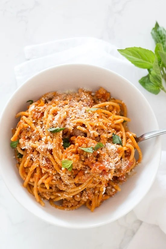 Instant Pot One-Pot Spaghetti with Meat Sauce is made with ground turkey and whole wheat pasta – hands down, the quickest and easiest way to get dinner on the table while making the whole family happy! Your solution to getting dinner on the table FAST on those busy weeknights and having everyone clean their plates!