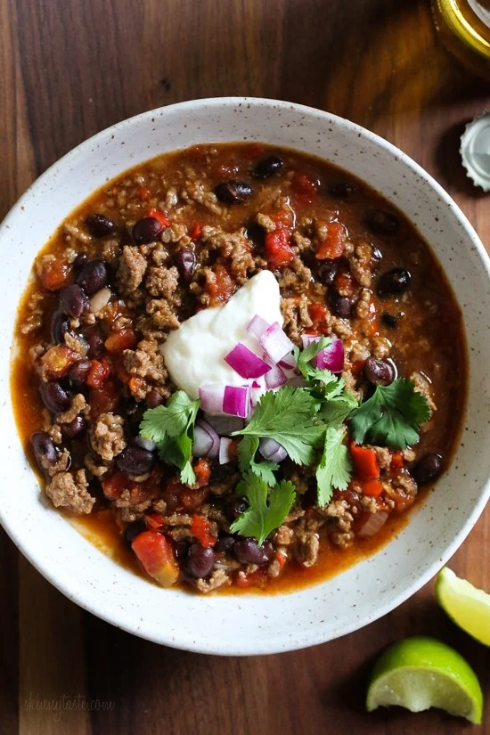 I love this quick and easy beef chili made with black beans, tomatoes, homemade chili spices and beer. This chili pleases all the palates in my house – not to too spicy (although you can kick it up if you wish), loaded with flavor, and ready in less than 30 minutes.