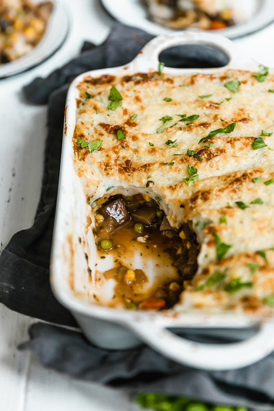 This fast and fresh vegetarian Shepherd's Pie made with Portobello mushroom, carrots, peas, corn, and onions, all topped with leftover Skinny Garlic Mashed Potatoes, is the perfect after-Holiday fix.