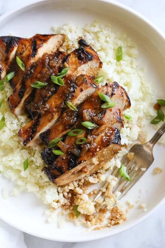 Grilled Bourbon Chicken breasts are marinaded with soy sauce, Bourbon, brown sugar, ginger and spices then grilled until slightly caramelized on the outside and juicy on the inside.