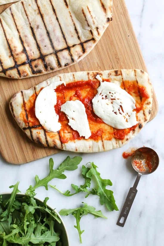 This easy Grilled Pizza is made from scratch with my easy yeast-free Greek yogurt dough, topped with sauce, mozzarella cheese and your choice of toppings. A great summer outdoor meal that whole family can enjoy!