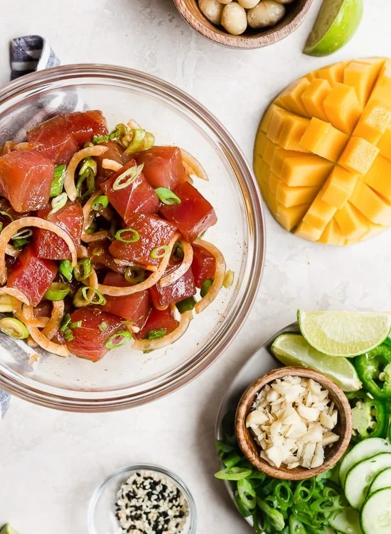 With marinated tuna, brown rice, avocado, cucumber, mango, macadamias and scallions, this Hawaiian style quick-cook Ahi Poke Bowl is perfect for hot summer nights.