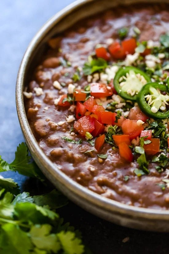 If you love the flavor of refried beans but would rather avoid the lard they are typically cooked in, you'll love this easy, fat-free version made in the Instant Pot.