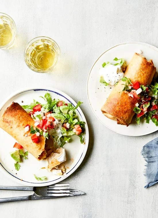 Chimichangas, deep-fried burritos popular in Tex-Mex cuisine, are seriously delicious, but usually dripping in grease and loaded with calories. These lighter chicken, green chile, and pepper Jack cheese Chimichangas are a much healthier twist on the classic.