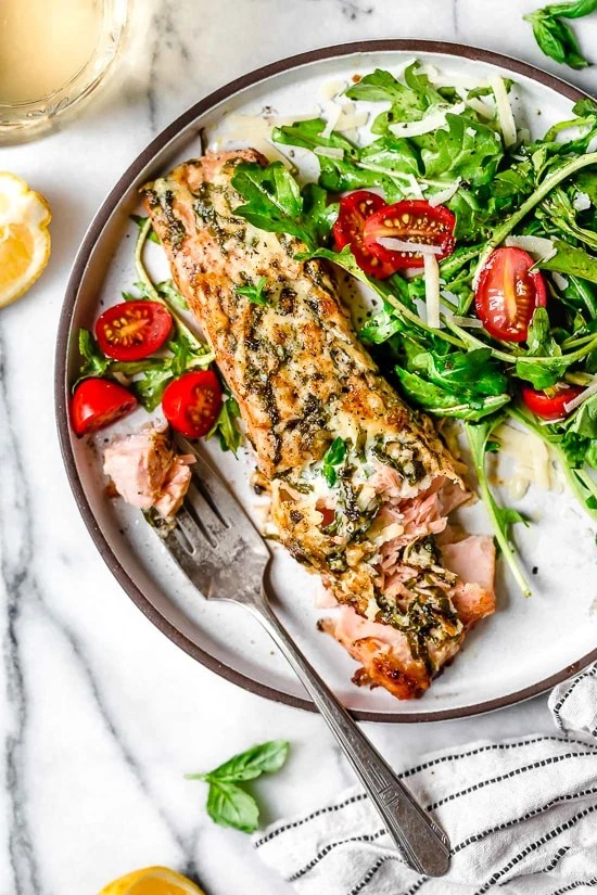 I'm obsessed with this Air Fryer Basil-Parmesan Salmon recipe! Making salmon in the air fryer is quick and easy, and the fish comes out so juicy inside.