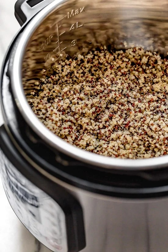 A foolproof method for making perfect, fluffy quinoa in the Instant Pot for adding to salads, bowls and so much more.