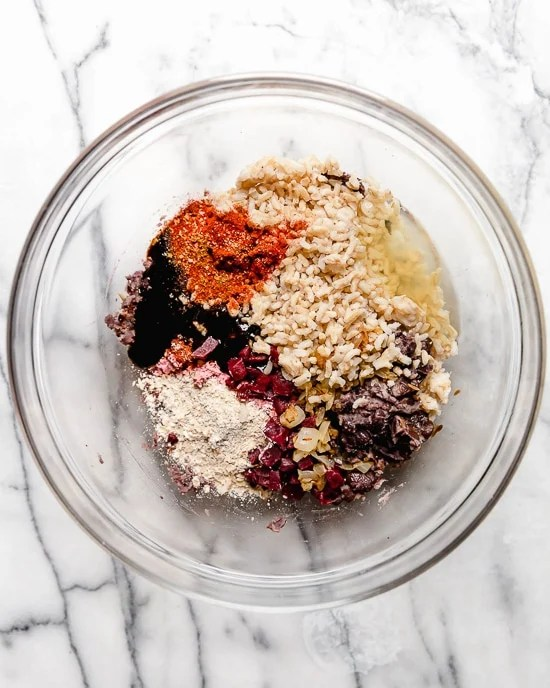 This is a veggie burger that even hearty meat-eaters will love! Made with beans, oats, brown rice, beets and a whole lot of spices, this veggie burger is a real crowd pleaser.