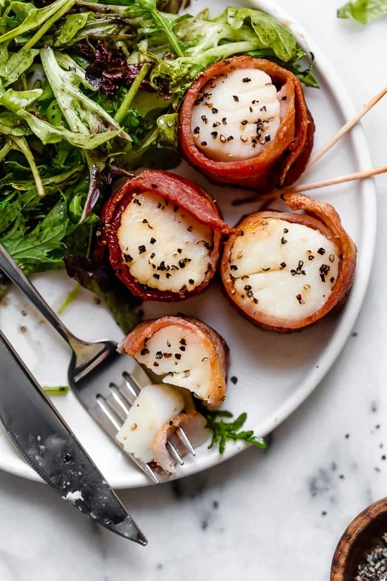 Air Fryer Bacon Wrapped Scallops are so easy, made with just two ingredients! Elegant enough to impress guests yet easy enough to make any weeknight for your family.