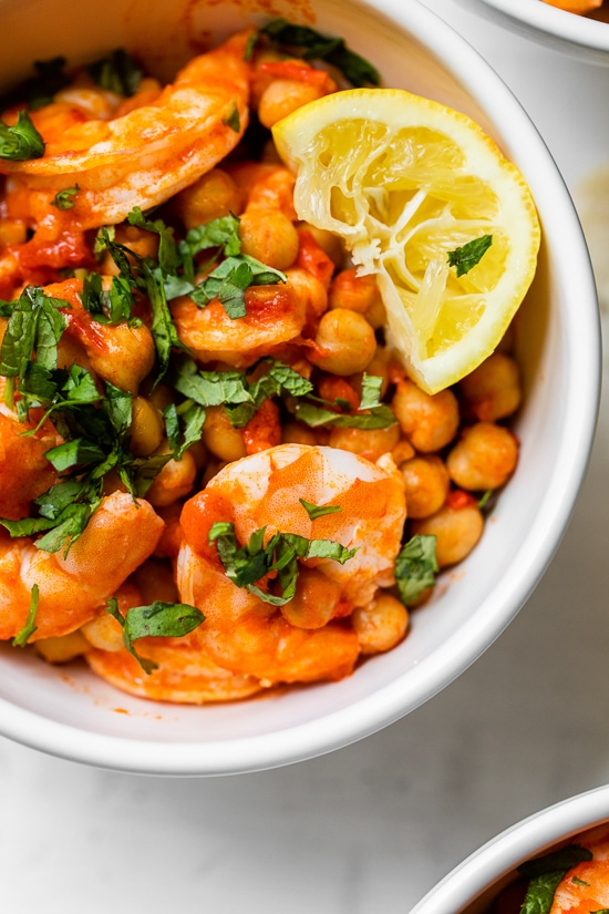 This easy Harissa Shrimp and Chickpea dish is super fast, made all in one skillet, and takes under 10 minutes to make. A great way to use pantry and freezer staples.