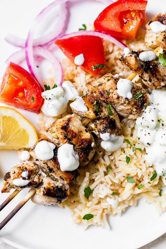 Grilled Chicken Kabobs on a plate with rice pilaf