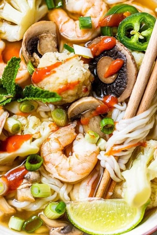 Shrimp veggies and noodle soup with chopsticks
