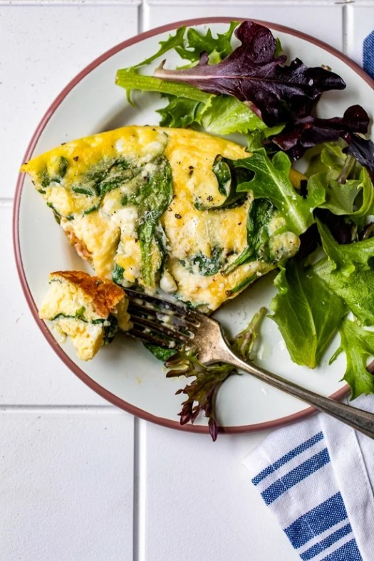 frittata on a plate with salad.