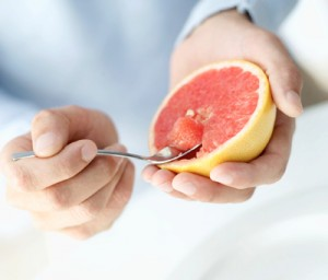 eating fruit with spoon