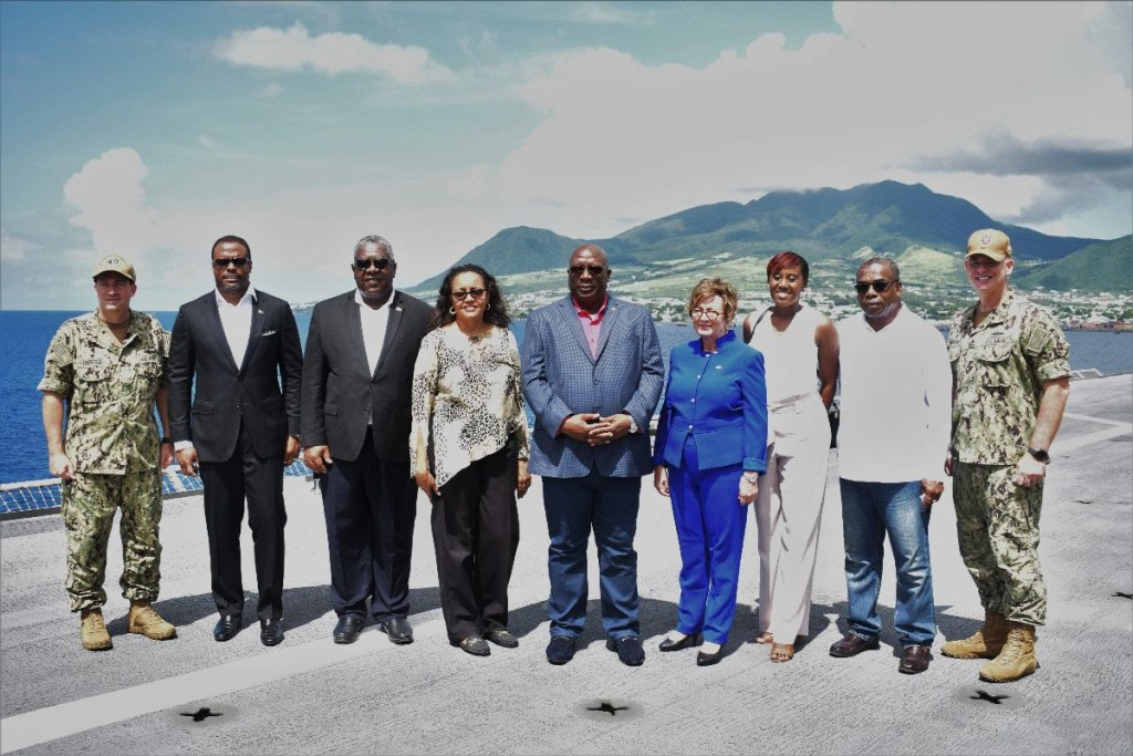 Members of the Team Unity administration, led by Prime Minister Harris, pictured with U.S. Ambassador to Barbados, the Eastern Caribbean, and the Organization of Eastern Caribbean States, Her Excellency Linda S. Taglialatela and officers of the US Navy ship Comfort.