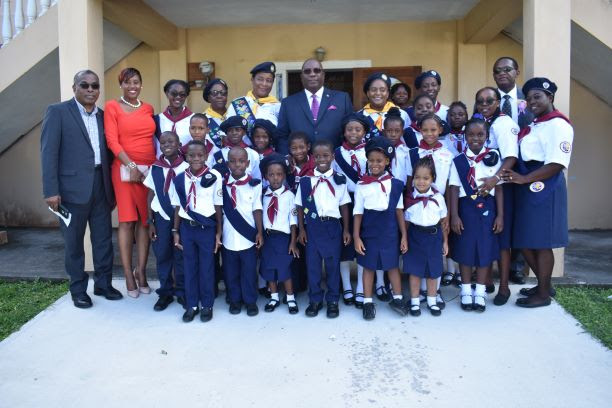 Photo: Prime Minister Harris and his Cabinet colleagues Hon. Ian Patches Liburd and Hon. Eugene Hamilton pose with Seventh-Day Adventist Pathfinders.