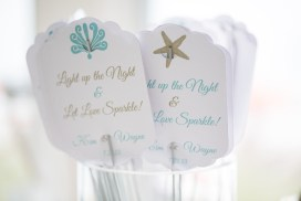 At the end of the evening, guests lit sparklers on the beach. Cards by SKO Designs. Photo by Nicole Lopez Photography.