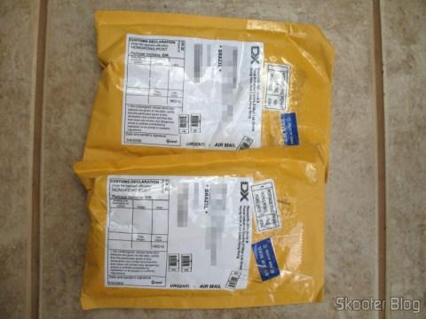 Pacotes da DealExtreme: adaptadores AA-para-D e AA-para-C