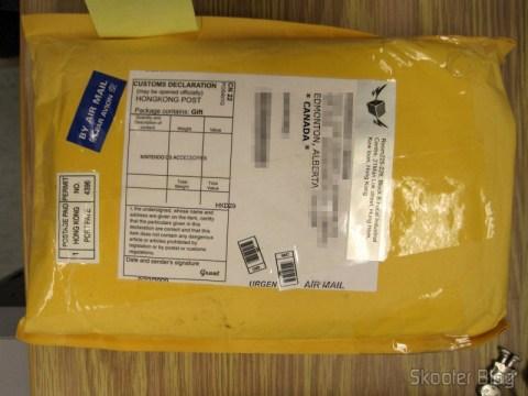 Pacote da DealExtreme com o case dentro, sem registro e sem tributação