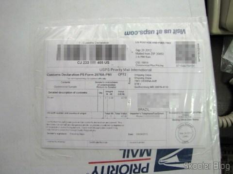 Caixa da USPS com o Roteador Wireless Gigabit 1300Mbps ASUS RT-AC66U (ASUS RT-AC66U 1300 Mbps Gigabit Wireless Router)