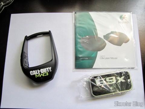 O segundo casco, manual e estojo com os pesos do Mouse Logitech G9x - Edição Call of Duty: Modern Warfare 3 (New Logitech G9X Gaming Mouse Call of Duty: MW3 Edition)